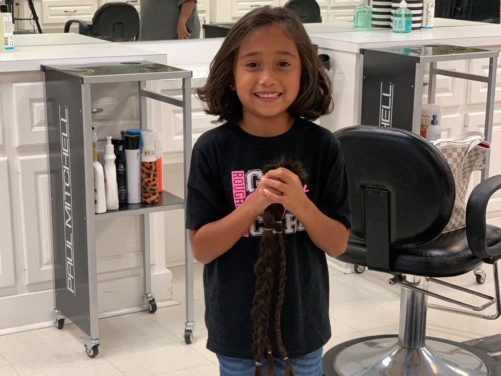 Six year old donates hair to children with hair loss.